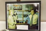 Photograph of Pat Nixon and John V. Brennan Shopping in Peking, China