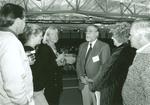 Professor Rodney Della Santa (center) Speaking With Parents