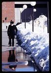 Man Walks Path with Melting Snow