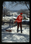 Woman Carries Sled across the Campus