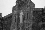 Snow Falls on Statue of Mary